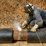 Welder working pipeline